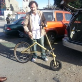 Artist Tom Kabat with Ski Bike Sculputre